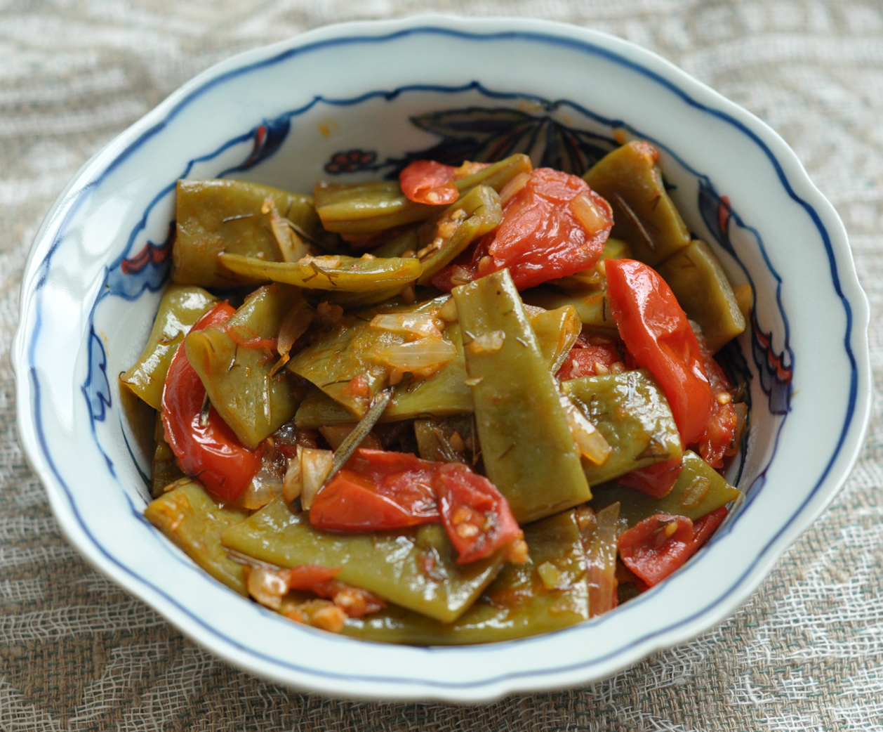 Greek-style green beans stewed with tomatoes, dill and rosemary