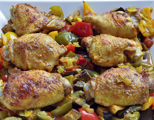 Moroccan-style chicken thighs baked with peppers, eggplant and ...