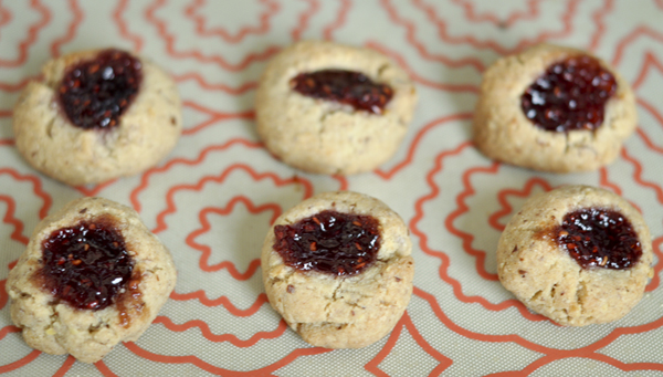 Raspberry Thumbprints on cookie sheet